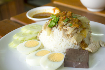 Hainanese chicken rice boil egg on white plate