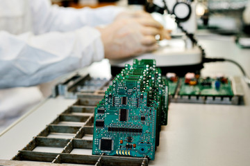 Boards are in a row. Factory for the production of chips.