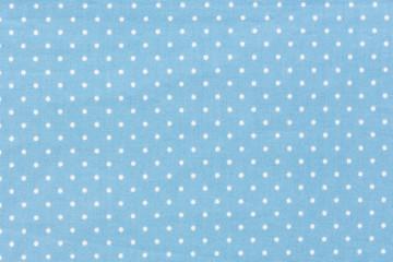 Seamless blue polka dot background pattern.