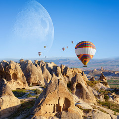 Poster Marron chocolat Hot air ballooning in sunrise in Cappadocia, Turkey. Elements of this image furnished by NASA