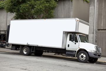White Moving Van Parked on Urban Street