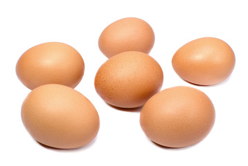Brown chicken eggs isolated on white background