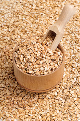 Background of oats in wooden bowl and scoop. Top view, high resolution product
