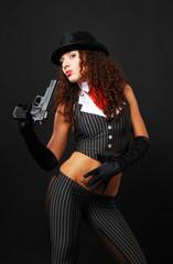 Pretty gangster with a handgun.