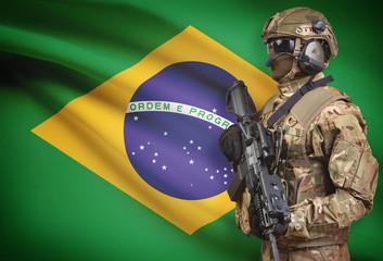 Soldier in helmet holding machine gun with flag on background series - Brazil