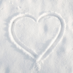 Drawing of heart on snow.