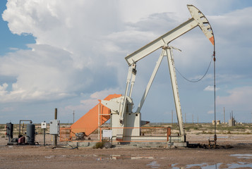 Pump jack pumping oil in west Texas near Midland/Odessa