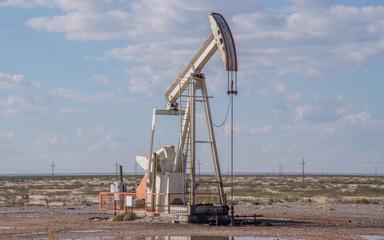 Pump jack pumping oil in west Texas near Midland/Odessa