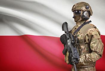 Soldier in helmet holding machine gun with flag on background series - Poland
