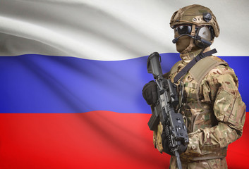 Soldier in helmet holding machine gun with flag on background series - Russia