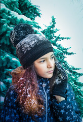 Winter portrait of a girl in a cap