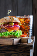 Cold drink and burger made of vegetables, beef