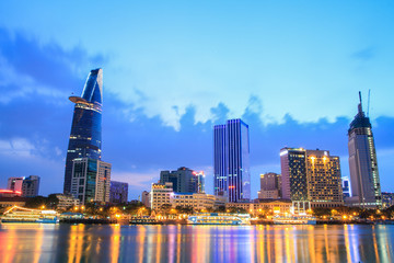 Night view of Downtown center of Ho Chi Minh city on Saigon riverbank in twilight, Vietnam.