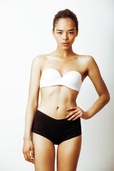 young pretty african american girl in sport underwear posing on white background, multi races woman model, lifestyle people concept