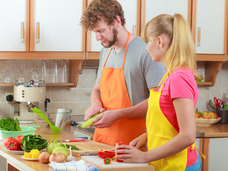 Couple preparing fresh vegetables salad. Diet