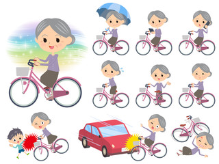 Purple clothes grandmother ride on city bicycle