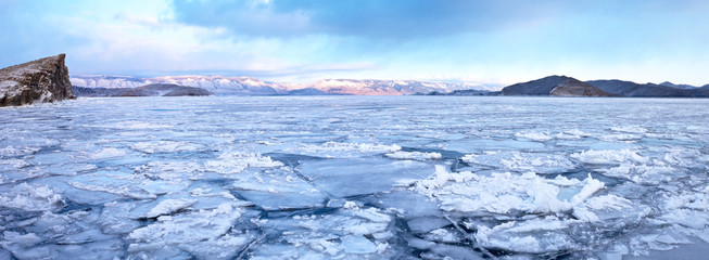 Lake Baikal in the December frost. The process of freezing ice. Panorama of the Maloe More (Small Sea)