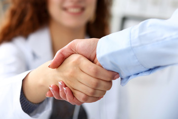 Female medicine doctor shake hand as hello with businesswoman