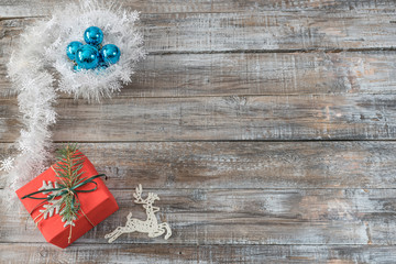 Christmas decorations on a wooden background, top view with cop