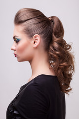 Woman with professional hairstyle and make up