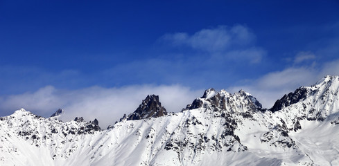 Panoramic view on snowy mountains at sun day