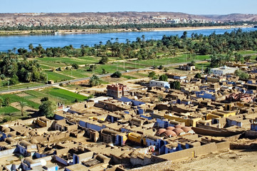 Overview of Nubian village with Nile River and in the background, Egypt