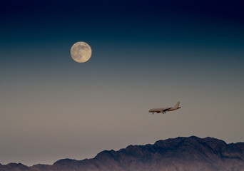Super moon and landing airplane