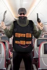 armed terrorist threatens the flying plane