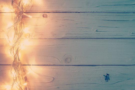 christmas light and christmas decoration on white wood backgroun