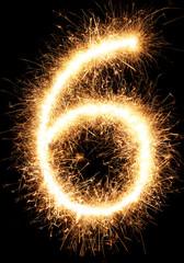 Sparkler firework light number 6 isolated on black