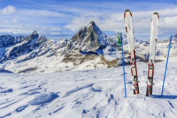 Ski Equipment with panoramic view of Matterhorn on a clear sunny