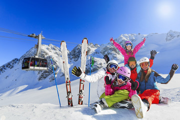 Skiing, winter, snow, sun and fun - family enjoying winter vacat