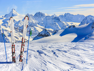Ski equipment with amazing view of swiss famous mountains in b