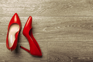 Red women shoes on wooden background