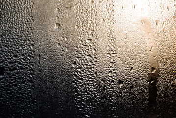misted glass with drops water background