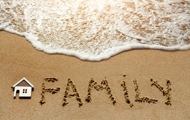 House and family on the sand beach - property investment concept