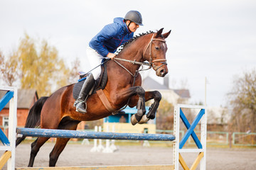 Young horseman on show jumping competition