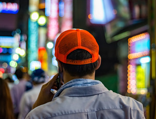 Man with phone and red cap