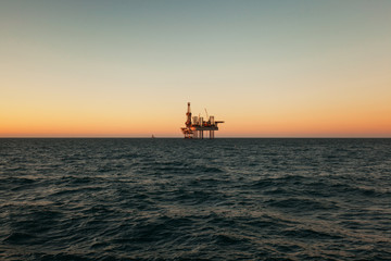 Silhouette of Offshore Jack Up Rig in The Middle of The Sea at Sunset Time. For produce oil and gas fuel
