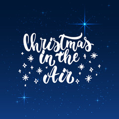 Christmas in the Air - lettering Christmas and New Year holiday calligraphy phrase isolated on the shining background with stars. Fun brush ink typography for photo overlays, t-shirt print, poster