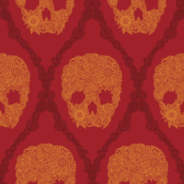 Doodle floral skulls damask seamless pattern in bright orange over red. Halloween skull seamless pattern.