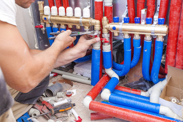 Plumber mounted distributor of central heating. Pipe fittings Central Heating Distributor.