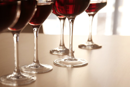 Glasses of red wine on table in restaurant