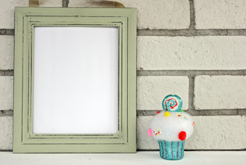 Christmas and New Year background. Empty picture frame, cupcake with with copy space blank tag on white background. Copy space image. Scandinavian style home interior decoration
