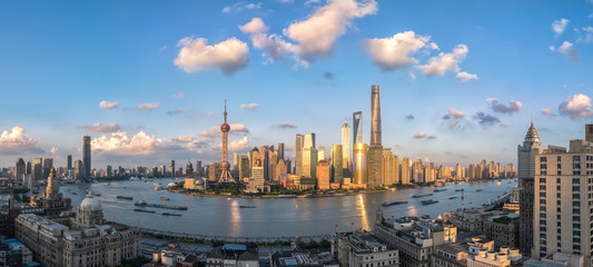 panoramic view of shanghai skyline and huangpu river in nightfall , China