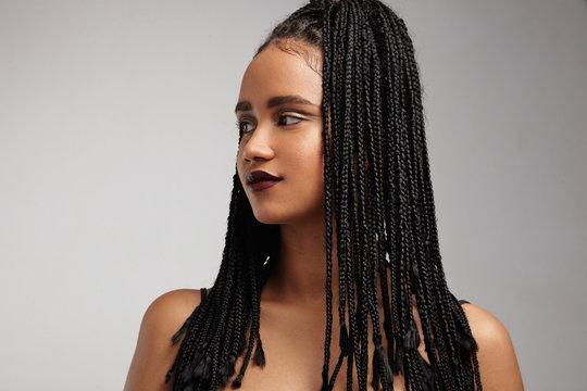 black woman's profile. African braids. false hair concept