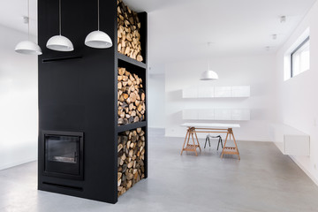 Spacious, bright home office and modern fireplace with firewood