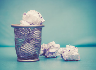 Recycle,trash bin and crumpled paper balls; vintage tone style