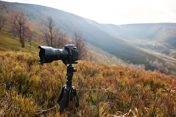 Modern professional dslr camera on a tripod, outdoor photography