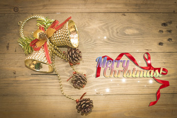Christmas bell on wooden background
